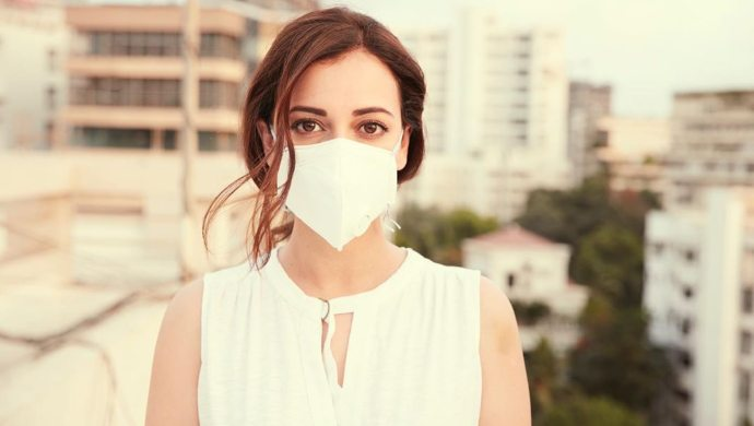 Dia Mirza poses with a face mask